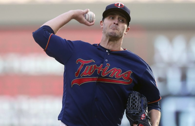 Minnesota Twins pitcher Jake Odorizzi throws against the Houston Astros in the first inning of a baseball game Monday, April 29, 2019, in Minneapolis. (AP Photo/Jim Mone)