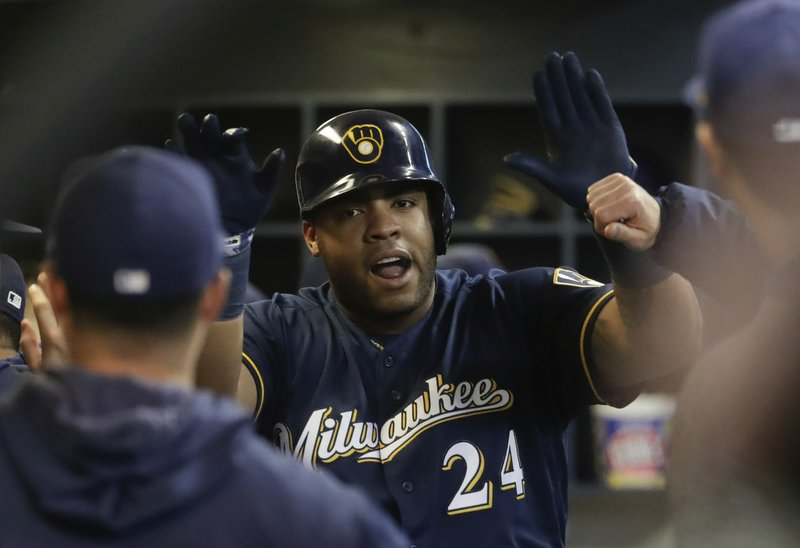 Milwaukee Brewers' Jesus Aguilar celebrates his home run during the third inning of a baseball game against the Colorado Rockies Monday, April 29, 2019, in Milwaukee. (AP Photo/Morry Gash)