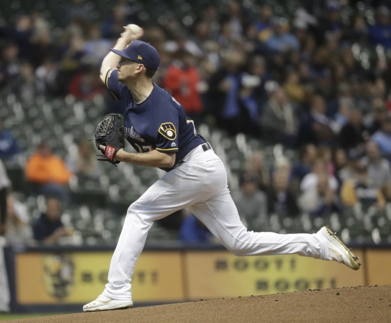 Milwaukee Brewers starting pitcher Zach Davies throws during the first inning of a baseball game against the Colorado Rockies Monday, April 29, 2019, in Milwaukee. (AP Photo/Morry Gash)