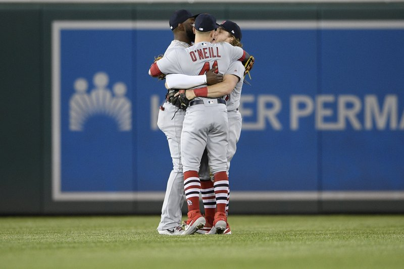 St. Louis Cardinals' Marcell Ozuna, left, Tyler O'Neill (41) and Harrison Bader, right, celebrate after a baseball game against the Washington Nationals, Monday, April 29, 2019, in Washington. (AP Photo/Nick Wass)