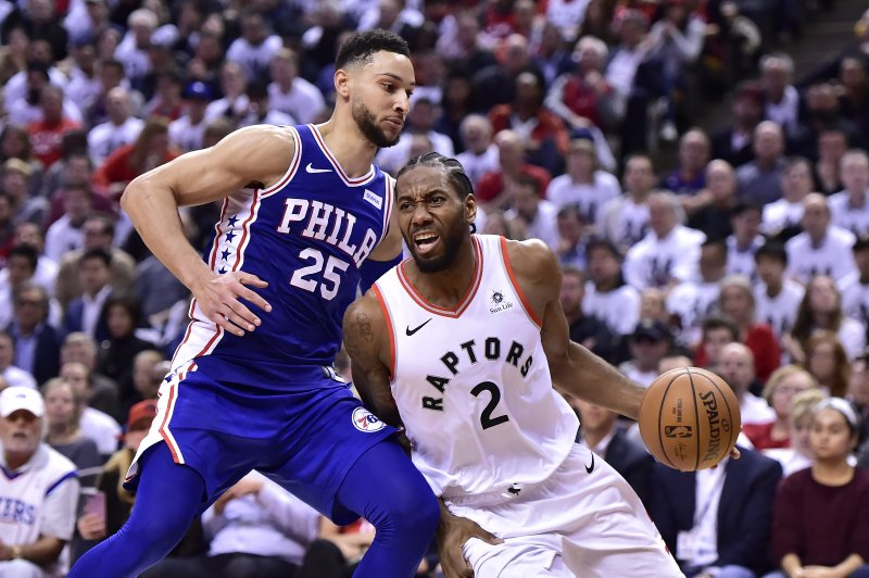 Toronto Raptors forward Kawhi Leonard (2) drives to the net as Philadelphia 76ers guard Ben Simmons (25) defends during second-half, second-round NBA basketball playoff action in Toronto, Monday, April 29, 2019. (Frank Gunn/The Canadian Press via AP)
