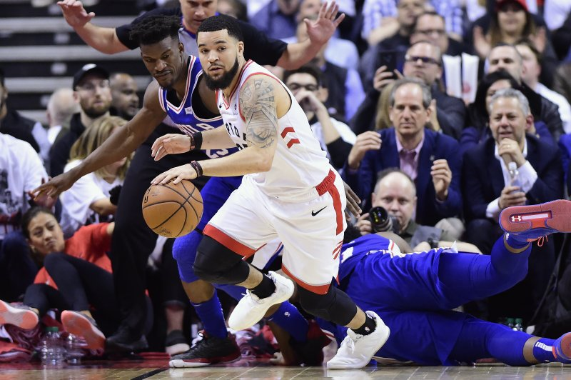 Toronto Raptors guard Fred VanVleet (23) recovers the ball ahead of Philadelphia 76ers guard Jimmy Butler (23) during second-half, second-round NBA basketball playoff action in Toronto, Monday, April 29, 2019. (Frank Gunn/The Canadian Press via AP)