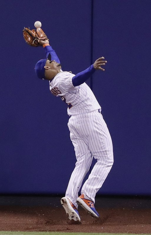 New York Mets center fielder Juan Lagares catches a ball hit by Cincinnati Reds' Joey Votto for an out during the seventh inning of a baseball game Monday, April 29, 2019, in New York. (AP Photo/Frank Franklin II)