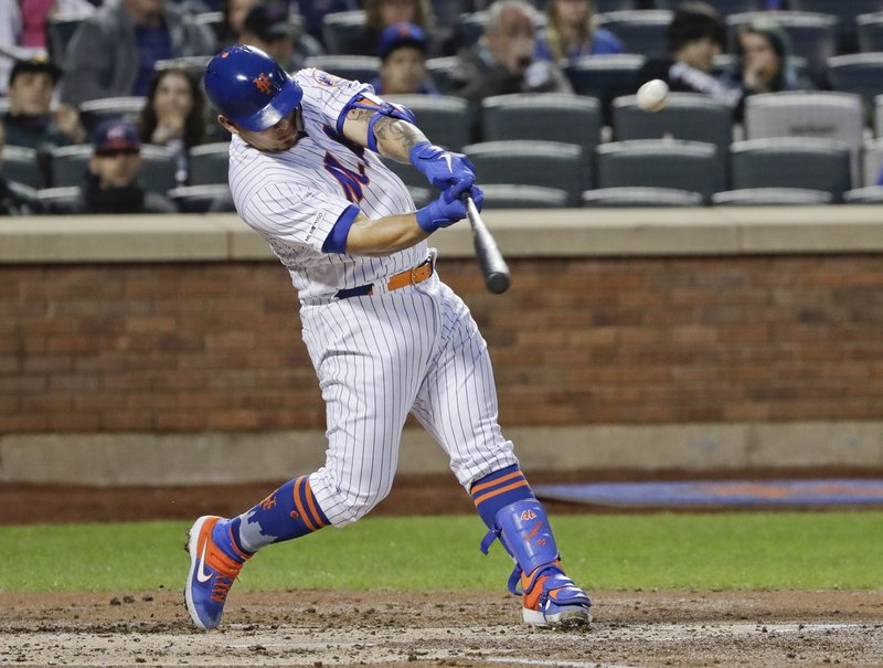 New York Mets' Wilson Ramos hits an RBI-double during the second inning of a baseball game against the Cincinnati Reds, Monday, April 29, 2019, in New York. (AP Photo/Frank Franklin II)