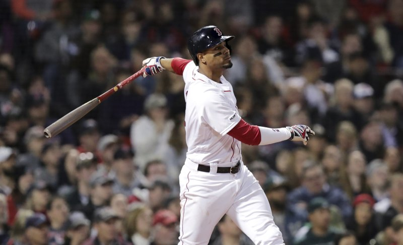 Boston Red Sox's Xander Bogaerts watches the flight of his two RBI double off Oakland Athletics starting pitcher Frankie Montas during the third inning of a baseball game at Fenway Park, Monday, April 29, 2019, in Boston. (AP Photo/Charles Krupa)