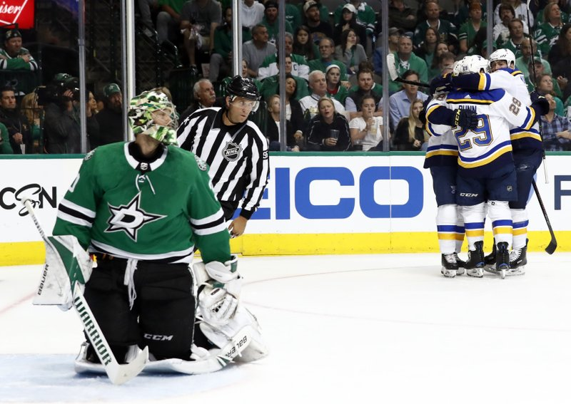 Dallas Stars goaltender Ben Bishop (30) kneels as St. Louis Blues' Robert Thomas (18), Tyler Bozak (21), Vince Dunn (29) and Pat Maroon, right rear, celebrate a goal by Bozak in the second period of Game 3 of an NHL second-round hockey playoff series in Dallas, Monday, April 29, 2019. (AP Photo/Tony Gutierrez)