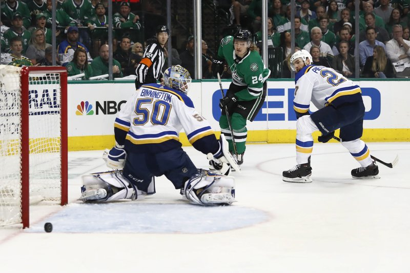 Dallas Stars' Roope Hintz (24), of Finland, and St. Louis Blues' Alex Pietrangelo, right, watch the puck slip past Blues goaltender Jordan Binnington (50) during the first period in Game 3 of an NHL second-round hockey playoff series, Monday, April 29, 2019, in Dallas. (AP Photo/Tony Gutierrez)