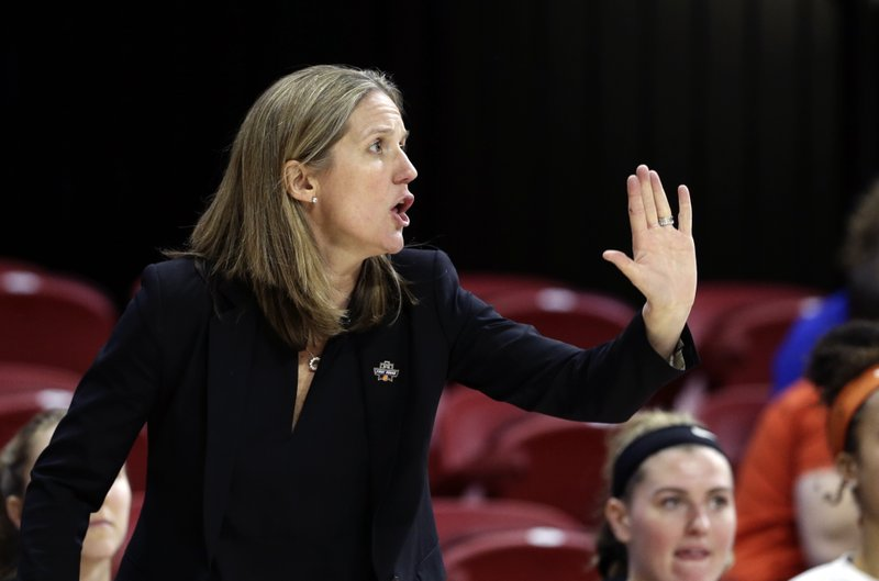 FILE - In this Saturday, March 23, 2019, file photo, Princeton head coach Courtney Banghart reacts during the second half of a first round women's college basketball game against Kentucky in the NCAA Tournament in Raleigh, N.C. A person with knowledge of the situation says North Carolina has reached a deal with Princeton's Banghart to become the Tar Heels' next women's basketball coach. (AP Photo/Gerry Broome, File)