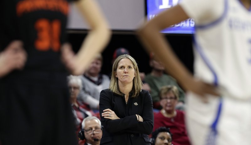FILE - In this Saturday, March 23, 2019, file photo, Princeton head coach Courtney Banghart looks on during the first half of a first-round women's college basketball game against Kentucky in the NCAA Tournament in Raleigh, N.C. A person with knowledge of the situation says North Carolina has reached a deal with Princeton's Banghart to become the Tar Heels' next women's basketball coach. (AP Photo/Gerry Broome, File)