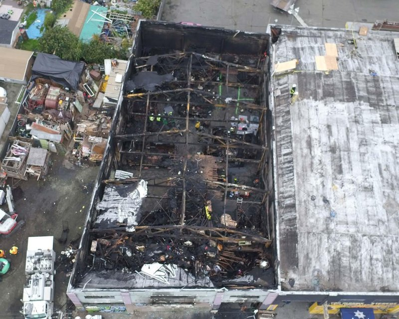 FILE - This undated file photo provided by the City of Oakland shows inside the burned warehouse after the deadly fire that broke out on Dec. 2, 2016, in Oakland, Calif. More than two years after 36 people died in the fire, Derick Almena and Max Harris, the two men who face charges of involuntary manslaughter, will stand trial on charges that they allegedly illegally converted the industrial building into an unlicensed entertainment venue and artist live-work space. (City of Oakland via AP, File)