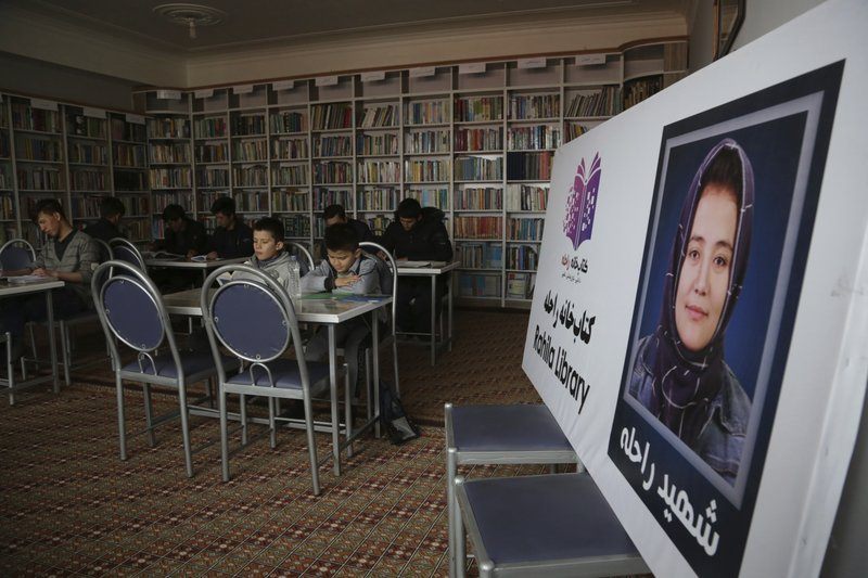 In this Tuesday, March 19, 2019, photo, Afghan students study at the Rahila library, in Kabul, Afghanistan. Launched in February by the Afghanistan Human Rights and Democracy Organization, the center seeks to salvage, protect and share memories and stories of civilian victims of the country's four decades of war. (AP Photo/Rahmat Gul)