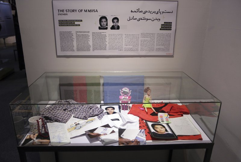 In this Saturday, Mar. 16, 2019, photo, belongings of Saima and Mohammad Sadiq are on display in the Afghanistan Center for Memory and Dialogue, in Kabul, Afghanistan. Launched in February by the Afghanistan Human Rights and Democracy Organization, the center seeks to salvage, protect and share memories and stories of civilian victims of the country's four decades of war. (AP Photo/Rahmat Gul)