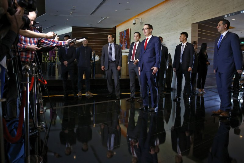 U.S. Treasury Secretary Steven Mnuchin speaks to the media upon his arrival at a hotel in Beijing, Tuesday, April 30, 2019. Mnuchin arrived in China's capital to hold a new high-level trade talks with China on May 1. (AP Photo/Andy Wong)