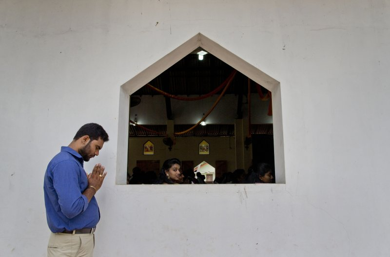 Catholics participate in a Mass at St. Joseph's church in Thannamunai, Sri Lanka, Tuesday, April 30, 2019. This small village in eastern Sri Lanka has held likely the first Mass since Catholic leaders closed all their churches for fear of more attacks after the Easter suicide bombings that killed over 250 people. (AP Photo/Gemunu Amarasinghe)
