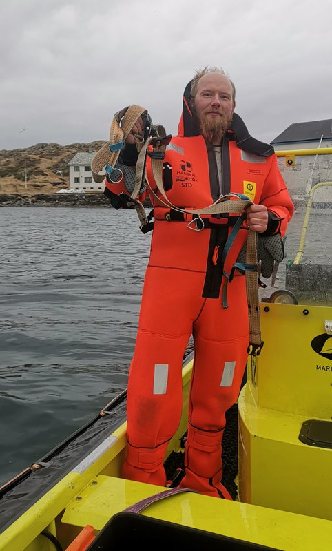 CORRECTING NAME TO JOAR HESTEN - Norwegian fisherman Joar Hesten, who jumped into the frigid Arctic water to cut the harness from a beluga whale off the northern Norwegian coast Friday, April 26, 2019.  The harness strap which features a mount for an action camera, says