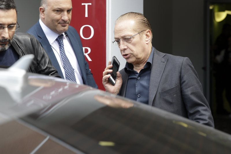 Paolo Berlusconi, brother of former Italian Premier Silvio Berlusconi, leaves Milan's San Raffaele hospital, Tuesday, April 30, 2019. Former Italian Premier Silvio Berlusconi is in the hospital suffering from renal colic on the day he planned to present his candidates for European Parliament elections.(AP Photo/Luca Bruno)