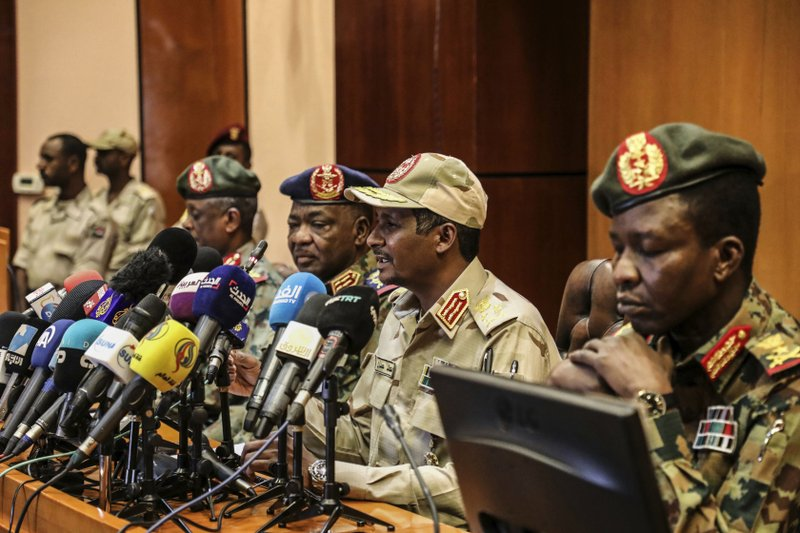 "Gen. Mohamed Hamdan Dagalo, the deputy head of the military council, second right, speaks at a press conference in Khartoum, Sudan, Tuesday, April 30, 2019. Sudan's ruling military council warned protesters against any further ""chaos"" as organizers call for mass rallies later this week. Dagalo, better known by his nickname"