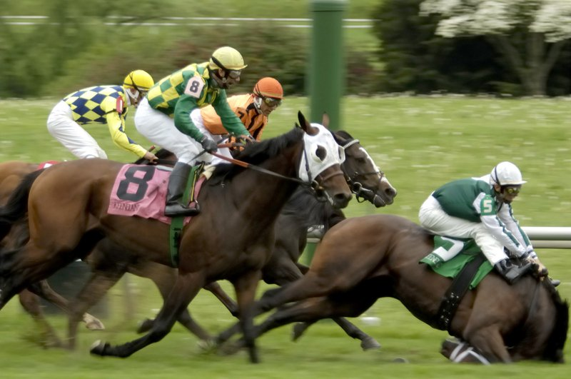 FILE - In this April 20, 2006, file photo, Up an Octave, right, ridden by John Velazquez, breaks down and falls about a sixteenth of a mile past the finish line after winning the Forerunner Stakes horse race at Keeneland in Lexington, Ky. Up an Octave had to be euthanized on the track. No. 8 is Yate's Black Cat, ridden by Rene Douglas. Horse racing finds itself under intense scrutiny at a time of year when Saturday's Kentucky Derby kicks off the Triple Crown series and interest among the general public is at its highest. The deaths of 23 horses over three months at Santa Anita in California have roiled an industry already battered by declining attendance, increased competition for gambling dollars, and the ire of animal rights activists. (AP Photo/Charles Bauer, File)