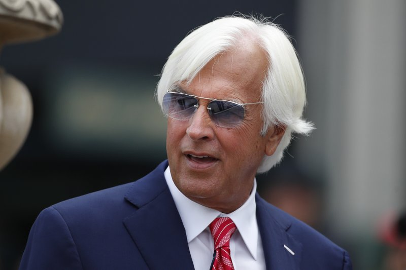 FILE - In this April 7, 2018, file photo, trainer Bob Baffert stands near the winner's circle ahead of the Santa Anita Derby horse race at Santa Anita Park in Arcadia, Calif. The deaths of 23 horses over three months at Santa Anita in California have roiled an industry already battered by declining attendance, increased competition for gambling dollars, and the ire of animal rights activists. Several trainers, including five-time Kentucky Derby winner Bob Baffert, believe the rare winter rains that inundated Santa Anita after years of drought were the main culprit in the deaths. Baffert didn't lose any horses, noting that he chose not to train or race on rainy days. (AP Photo/Jae C. Hong, File)