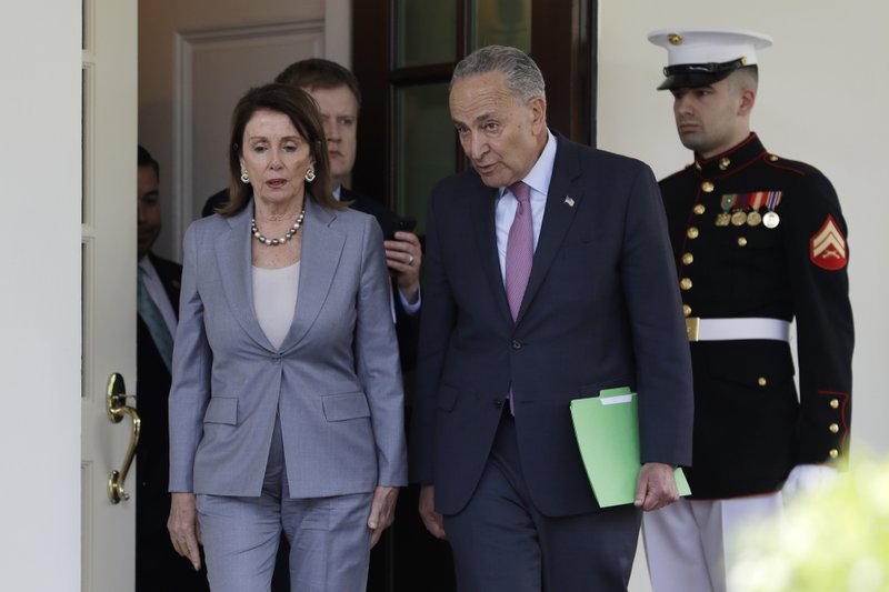 Speaker of the House Nancy Pelosi of Calif. and Senate Minority Leader Sen. Chuck Schumer of N.Y. and other Democrats, walk out to talk to the media after meeting with President Donald Trump in the Cabinet Room of the White House, Tuesday, April 30, 2019, in Washington. (AP Photo/Evan Vucci)