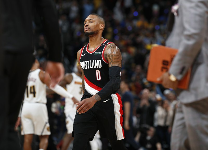 Portland Trail Blazers guard Damian Lillard heads off he court as time runs out in the second half of Game 1 of an NBA basketball second-round playoff series against the Denver Nuggets, Monday, April 29, 2019, in Denver. The Nuggets won 121-113. (AP Photo/David Zalubowski)