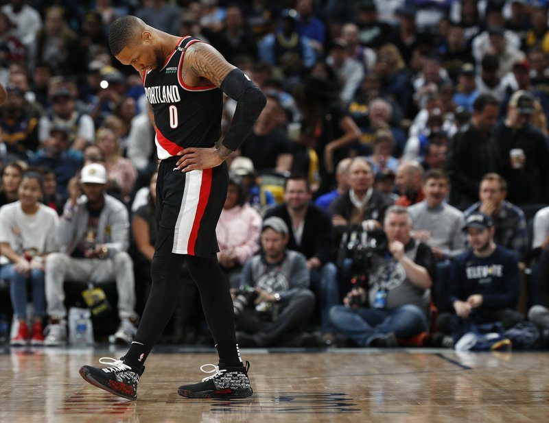 Portland Trail Blazers guard Damian Lillard reacts after being called for a foul in the second half of Game 1 of an NBA basketball second-round playoff series against the Denver Nuggets, Monday, April 29, 2019, in Denver. The Nuggets won 121-113. (AP Photo/David Zalubowski)
