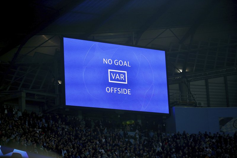 A big screen shows Manchester City's Raheem Sterling's goal was disallowed for offside against Manchester City's Sergio Aguero following a VAR review during the Champions League quarterfinal, second leg, soccer match between Manchester City and Tottenham Hotspur at the Etihad Stadium in Manchester, England, Wednesday, April 17, 2019. (AP Photo/Dave Thompson)