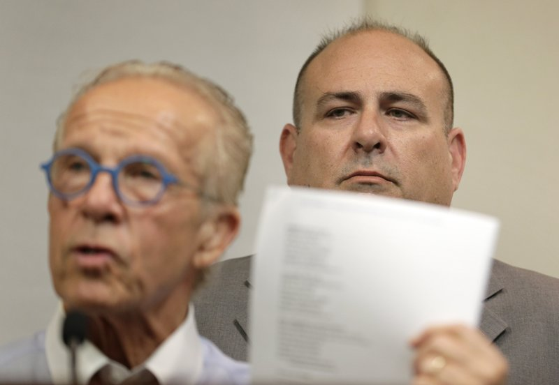 While Richard Halvorson, right, listens, attorney Jeff Anderson speaks during a news conference in Newark, N.J., Tuesday, April 30, 2019. Halvorson is alleging sexual abuse in a lawsuit filed against the Boy Scouts of America. (AP Photo/Seth Wenig)
