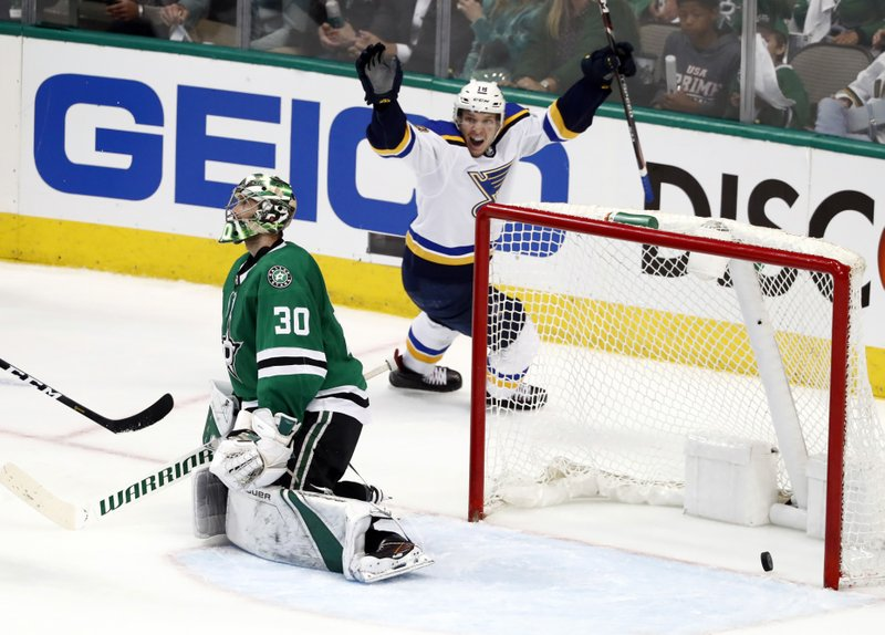 Dallas Stars' Ben Bishop (30) kneels by the net as St. Louis Blues' Robert Thomas, top, celebrates a goal by Blues' Alex Pietrangelo in the third period of Game 3 of an NHL second-round hockey playoff series in Dallas, Monday, April 29, 2019. (AP Photo/Tony Gutierrez)