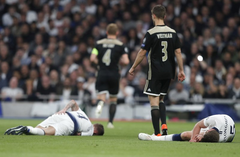 Tottenham's Jan Vertonghen, right, and Tottenham's Toby Alderweireld, left, lie on the pitch after colliding during the Champions League semifinal first leg soccer match between Tottenham Hotspur and Ajax at the Tottenham Hotspur stadium in London, Tuesday, April 30, 2019. (AP Photo/Frank Augstein)