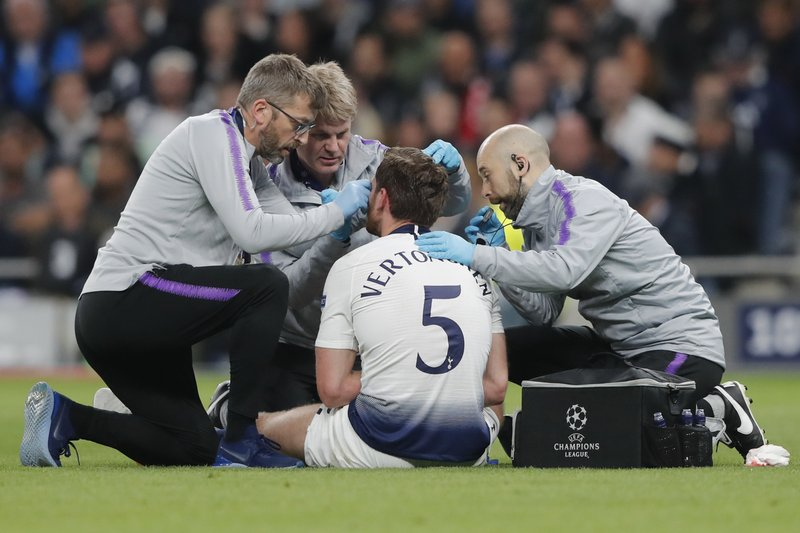 Tottenham's Jan Vertonghen is treated for a head wound during the Champions League semifinal first leg soccer match between Tottenham Hotspur and Ajax at the Tottenham Hotspur stadium in London, Tuesday, April 30, 2019. (AP Photo/Frank Augstein)