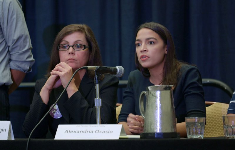 This image released by Netflix shows Paula Jean Swearingen, left, and Alexandria Ocasio-Cortez in a scene from the documentary