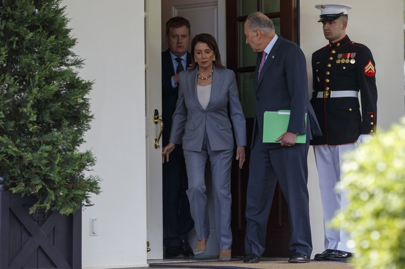 Speaker of the House Nancy Pelosi of Calif., and Senate Minority Leader Sen. Chuck Schumer of N.Y., walk out of the White House after meeting with President Donald Trump about infrastructure, Tuesday, April 30, 2019, in Washington. (AP Photo/Evan Vucci)