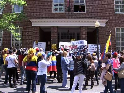 Pro-Juan Guaido protesters squared off in Washington with activists from the group Codepink in front of the Venezuelan Embassy. (April 30)