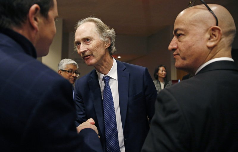United Nations Special Envoy for Syria Geir Pedersen, center, greets a reporter following a U.N. Security Council meeting on Syria at U.N. headquarters, Tuesday, April 30, 2019. (AP Photo/Kathy Willens)