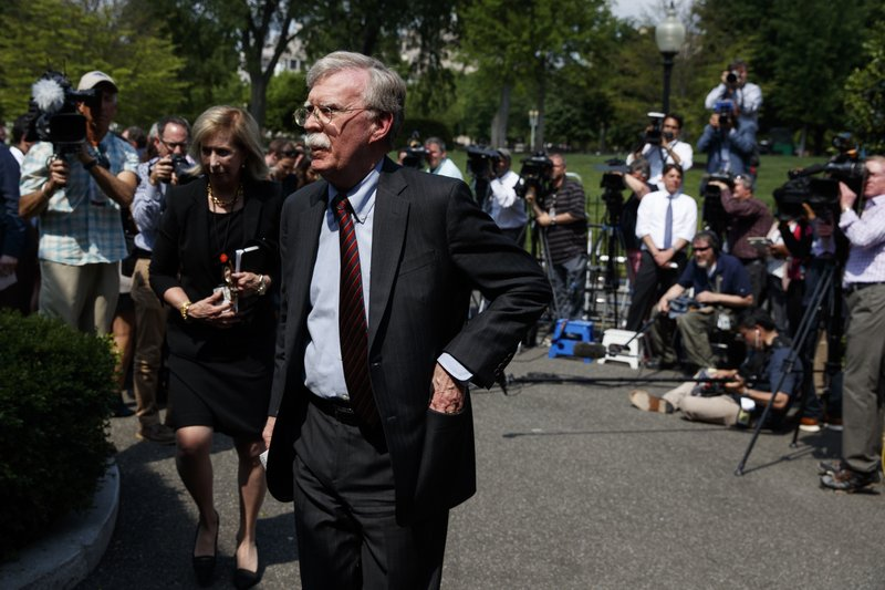 National security adviser John Bolton walks into the White House after speaking with reporters about the situation in Venezuela, Tuesday, April 30, 2019, in Washington. (AP Photo/Evan Vucci)