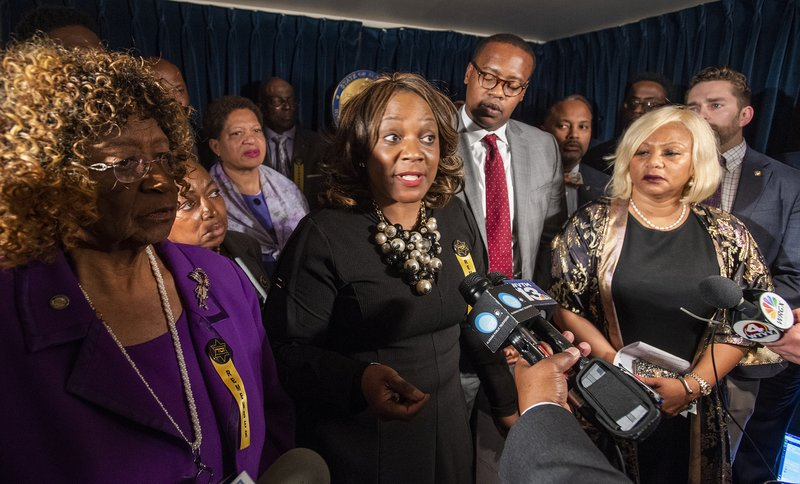 Rep. Merika Coleman, center, and members of the Democratic caucus walk out of the debate on the abortion ban bill to hold a press conference explaining their opposition to the bill at the Alabama Statehouse in Montgomery, Ala., on Tuesday April 30, 2019. (Mickey Welsh/The Montgomery Advertiser via AP)