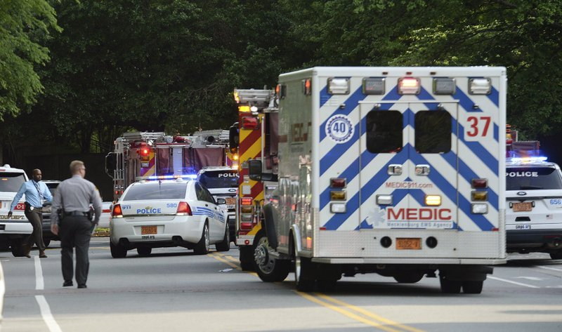Emergency vehicles cluster on Mary Alexander Road on the campus of University of North Carolina at Charlotte after a shooting Tuesday, April 30, 2019, in Charlotte, N.C. The shooting on the campus left at least a few people dead and several wounded Tuesday, prompting a lockdown and chaotic scene in the state's largest city. (John Simmons/The Charlotte Observer via AP)