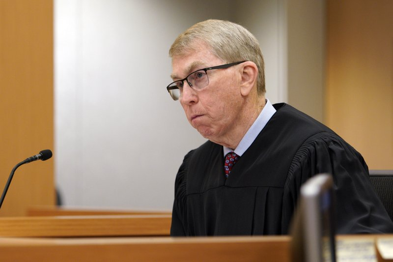 Judge Joseph P. Brannigan looks on during the arraignment hearing for John T. Earnest, Tuesday, April 30, 2019, in San Diego. Earnest faces charges of murder and attempted murder in the April 27 assault on the Chabad of Poway synagogue, which killed one woman and injured three people, including the rabbi. (Nelvin C. Cepeda/The San Diego Union-Tribune via AP, Pool)