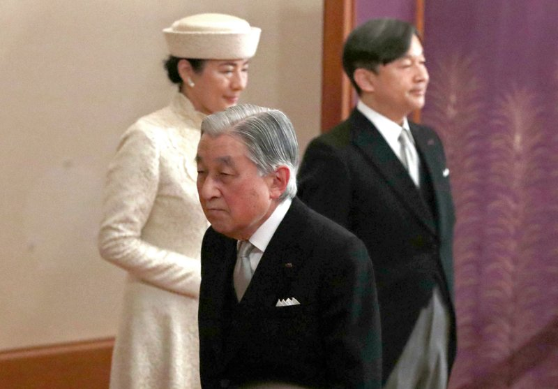 Japan's Emperor Akihito, center, leaves after the ceremony of his abdication past Crown Prince Naruhito, right, and Crown Princess Masako at the Imperial Palace in Tokyo, Tuesday, April 30, 2019. The 85-year-old Akihito ends his three-decade reign on Tuesday as his son Naruhito will ascend the Chrysanthemum throne on Wednesday. (Japan Pool via AP)