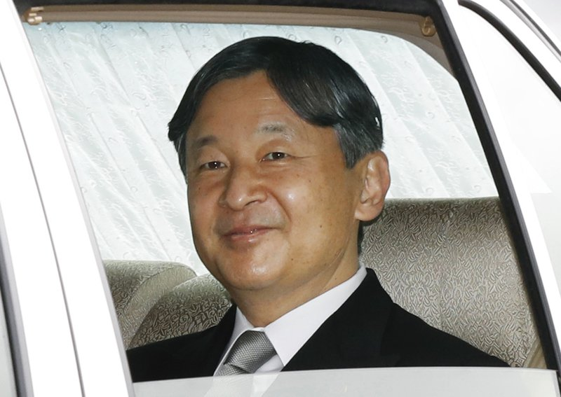 Japan's Crown Prince Naruhito, in a car, leaves the Imperial Palace in Tokyo Tuesday, April 30, 2019. Emperor Akihito is set to abdicate later in the day as Japan embraces the end of his reign with an emotion mixed with reminiscence and hopes for a new era. (Hiroko Harima/Kyodo News via AP)