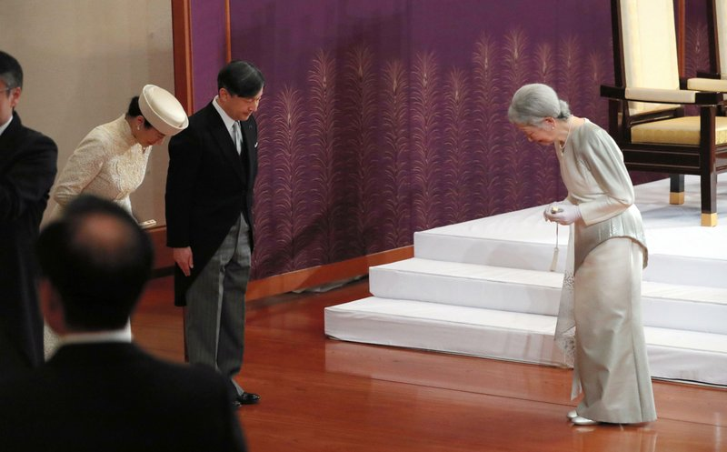 Japan's Empress Michiko, right, bows to Crown Prince Naruhito and Crown Princess Masako after the ceremony of Emperor Akihito's abdication at the Imperial Palace in Tokyo, Tuesday, April 30, 2019. Akihito announced his abdication at a palace ceremony Tuesday in his final address, as the nation embraced the end of his reign with reminiscence and hope for a new era. (Japan Pool via AP)