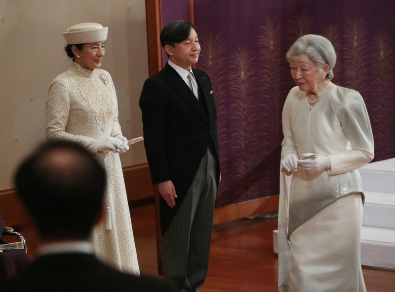 Japan's Crown Prince Naruhito and Crown Princess Masako, left, prepare to leave following Empress Michiko after the ceremony of Emperor Akihito's abdication at the Imperial Palace in Tokyo, Tuesday, April 30, 2019. Akihito announced his abdication at a palace ceremony Tuesday in his final address, as the nation embraced the end of his reign with reminiscence and hope for a new era. (Japan Pool via AP)