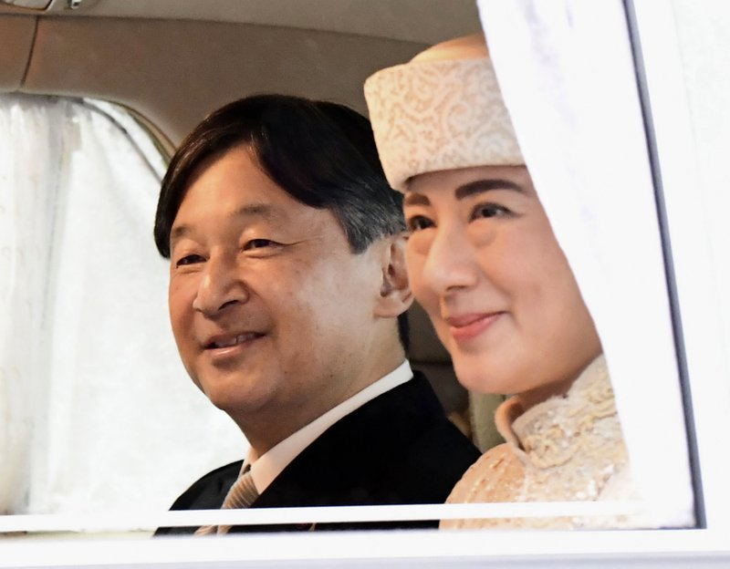 Japan's Crown Prince Naruhito, left, and Crown Princess Masako leaves the Imperial Palace after attending the ceremony of Emperor Akihito's abdication in Tokyo, Tuesday, April 30, 2019. Emperor Akihito announced his abdication at a palace ceremony Tuesday in his final address, as the nation embraced the end of his reign with reminiscence and hope for a new era.(Yohei Nishimura/Kyodo News via AP)