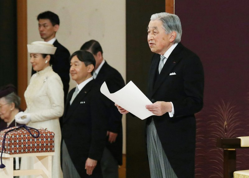 Japan's Emperor Akihito speaks during the ceremony of his abdication in front of other members of the royal families and top government officials at the Imperial Palace in Tokyo, Tuesday, April 30, 2019. The 85-year-old Akihito ends his three-decade reign on Tuesday as his son Crown Prince Naruhito, second from left, will ascend the Chrysanthemum throne on Wednesday. Crown Princess Masako is at left. (Japan Pool via AP)