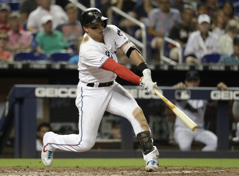 Miami Marlins' Martin Prado hits an RBI single during the second inning of the team's baseball game against the Cleveland Indians, Tuesday, April 30, 2019, in Miami. (AP Photo/Lynne Sladky)