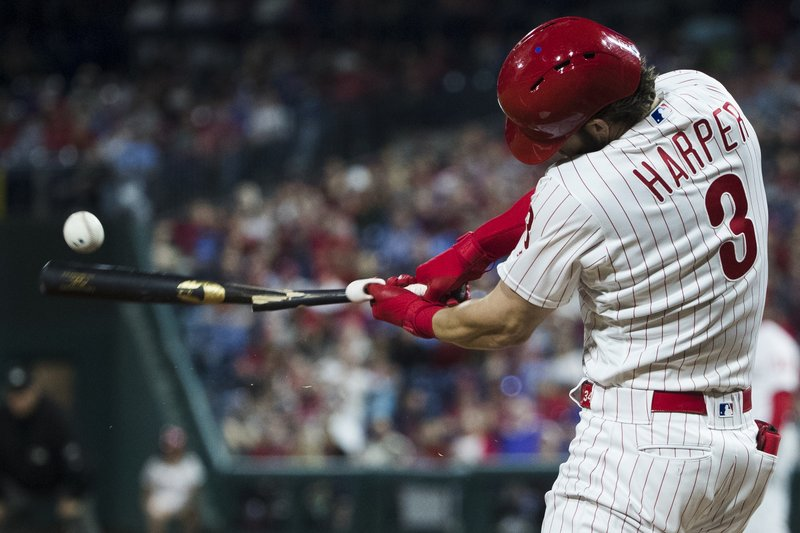 Philadelphia Phillies' Bryce Harper breaks his bat as he pops out during the third inning of a baseball game against the Detroit Tigers, Tuesday, April 30, 2019, in Philadelphia. (AP Photo/Matt Rourke)