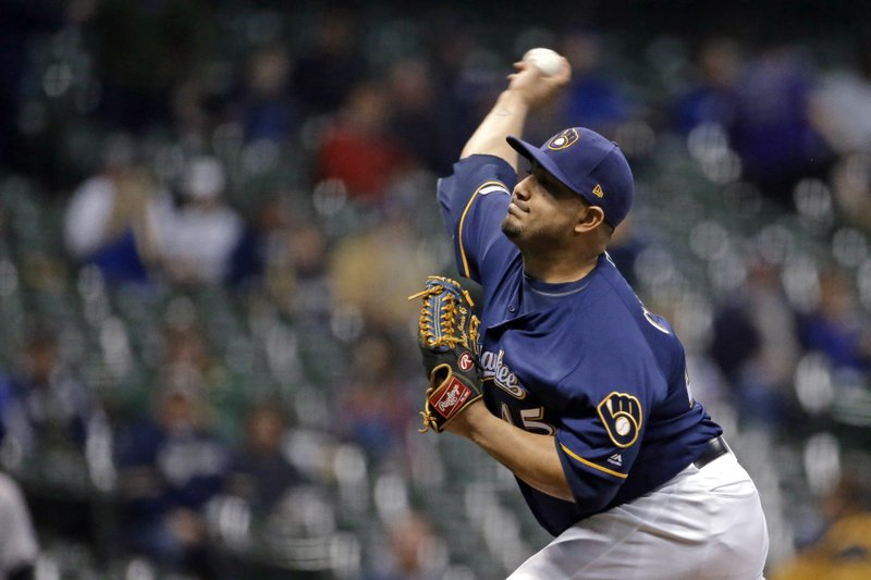 Milwaukee Brewers' Jhoulys Chacin pitches during the first inning of the team's baseball game against the Colorado Rockies on Tuesday, April 30, 2019, in Milwaukee. (AP Photo/Aaron Gash)