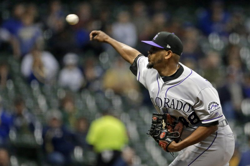 Colorado Rockies' German Marquez pitches during the first inning of the team's baseball game against the Milwaukee Brewers on Tuesday, April 30, 2019, in Milwaukee. (AP Photo/Aaron Gash)