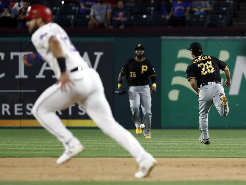 Texas Rangers' Joey Gallo advances to second as a single by Asdrubal Cabrera, not pictured, falls between Pittsburgh Pirates second baseman Adam Frazier (26) and right fielder Gregory Polanco (25) in the fourth inning of a baseball game in Arlington, Texas, Tuesday, April 30, 2019. The hit scored Hunter Pence and Elvis Andrus. (AP Photo/Tony Gutierrez)